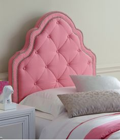 The Ivy upholstered headboard is a must have for your youth or teen. The simple camelback design with silver nailheads, creates a beautiful border to the comfortably padded tufting.  Fun pink fabric provides color and drama to your child's room that will complement her changing styles.