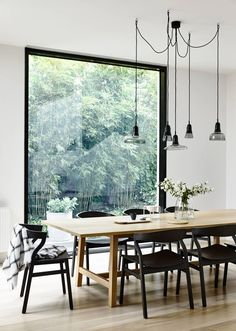 Light, bright and minimal Scandinavian style dining room. Interiors trends are often a reflection of the global climate: economics, current affairs and world events. They speak to our wants and needs, and often echo how we feel – safe and brave, or vulnerable and cautious?