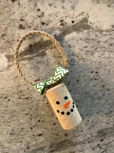 One handmade wine cork snowman ornament. Great gift or decoration for a wine bottle! Additional quantities and custom orders available. Please note: Cork will vary in shape, size, and color! Color chosen will be the prevailing color of the ribbon used. Wine Cork Art, Wine Cork Crafts, Wine Bottle Crafts, Wine Corks, Wine Bottles, Easy Christmas Crafts, Christmas Sewing, Christmas Ornaments, Christmas Decorations