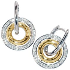 http://www.swansterling.com/negocio-de-joyeria.html   Aretes para Mujer en Plata ley 925 Rodinada, conformados por una silueta de circulo con circones de color Blanco y una silueta de circulo en lamina de oro 18k. Diametro aprox: 22mm.   2