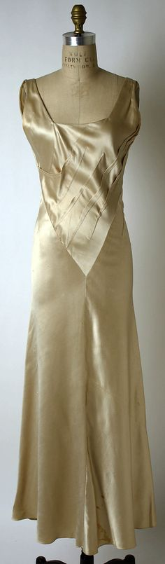 Bias cut charmeuse dress, ca 1935, Schiaparelli, MMA Collection.  Has simple cape/wrap that looks like it is a trapezoid shape