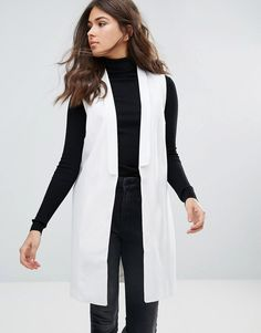 Buy it now. Y.A.S Longline Sleeveless Blazer - White. Blazer by Y.A.S., Smooth woven fabric, Added stretch for comfort, Fully lined, Shawl lapel, Open front, Functional pockets, Longline cut, Regular fit - true to size, Machine wash, 96% Polyester, 4% Elastane, Our model wears a UK 8/EU 36/US 4 and is 173cm/5'8 tall. Putting a clean twist on everyday essentials, Danish label Y.A.S. packs its understated-cool style into dresses, premium leather and tailored pieces. Think minimalist designs…