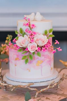 Perfectly Pink Wedding Cake with Love Birds An early Spring wedding can provide joy and hope for everyone awaiting warm weather, greener lawns, and blooming bushes. The kick-off of wedding season is full of excitement. Spring is the perfect time to say Wedding Cakes With Flowers, Beautiful Wedding Cakes, Beautiful Cakes, Amazing Cakes, Flower Cakes, Pink Wedding Cakes, Birthday Cake With Flowers, Wedding Cupcakes, Wedding Cake Designs