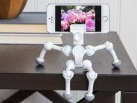 This little dynamo holds your phone, tablet, or camera whenever or wherever you need it. Hangs, stands, and poses in infinite ways.