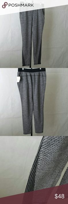 Free People Nordstrom Pants Gray and black small pattern, elastic waist, front pockets, and accented with the same colors striped section on the bottom sides of each leg. Free People Pants