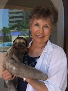 This is me holding Marie, a Sloth, in Cartagena, Colombia. She was quite big, and her fur was rather stiff. Did you know when they are up in a tree, they only come down once a week to relieve themselves?