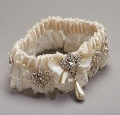 @Stacey Shew and @Megan Welch - love this vintage garter.....however, don't buy it if you like it as is (150.00) this would be easy to make!