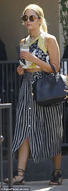 Chic: Ashley topped off her look with a stylish, black Givenchy Antigona leather satchel b...