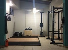 Rogue'd out garage gym - deadlift platform, R3 power rack, bumpers and probably even the bar. #ryourogue #garagegym