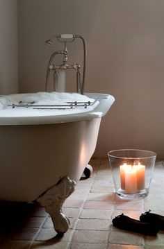 Claw foot tub, bubbles, and candles