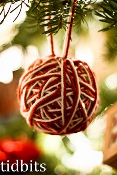 Yarn wrapped around styrofoam balls for baby friendly tree ornaments.