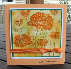 "By Dawn Turley. Negative stamp (""Poppy Background"" by Hero Arts) inked with Distress inks (tie dye, spiced marmalade, & shabby shutters), stamped, then image heat embossed with clear powder. Flowers sponged with spiced marmalade & stems with shabby shutters."