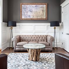 We love the way interior designer R. Smith Interiors featured a 100% hair on hide Appalachian rug from Surya in this sophisticated parlor (APP-1003). #suryaspaces
