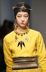 The Manish Arora Autumn/Winter 2013/14 show in Paris. The model wears turban jewels, Orion earrings, nose ring, Hasli necklace and more.