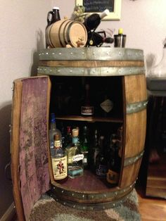 Wine barrel wet bar my husband made. Cost roughly $250 to make.