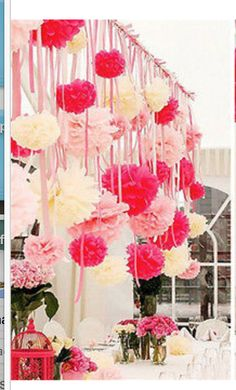 Retail store front window decorated with tissue pompoms and ribbon streamers  Perfect for Valentines day