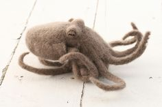 I was just googling pictures of octopus so I could make one by needle felting, and what do I find? A sweet needle-felted octopus! I am still making one though.