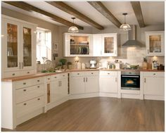 Kitchens - Burford Gloss Cream – Burford – Kitchen Families – Kitchen Collection – Howdens Joinery Co - Cream Kitchen Units, Cream Kitchen Cabinets, Gloss Kitchen, Shaker Kitchen, Cream Country Kitchen, Cream Cupboards, White Cabinets, Cream And Oak Kitchen, Kitchen Black