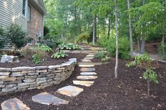 Natural Outdoor Landscapes | Stone Retaining Wall & Stepping Stones