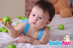 baby with green apples