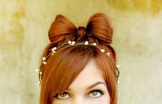 "How To Style a Hair Bow:  1. Start with a loose pony tail. 2-3. Take the rubber band (or pony tail holder) and pull the hair through half-way. 4. Flip the tail to the other side and repeat, leaving a small tail remaining.  5. Take the tail, fold over the middle, and pin in place. From underneath pin both sides of the ""bow"" in place. Tug on the loops until you have a perfect, messy bow!"