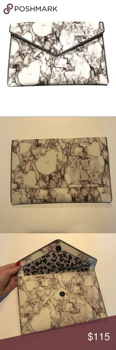 Rebecca Minkoff • Marble Leo Clutch Item: Rebecca Minkoff Leo Clutch - Marble  Condition: EUC used one time for my rehearsal dinner Measurements: Please Ask 😊 Bundle Discount: 10% off 2+ Bundle Notes: Please use the offer button **Please read my closet rules / NO trade rules before commenting** 💕 Don't forget to play my FOLLOW GAME to help each other gain more followers! Rebecca Minkoff Bags Clutches & Wristlets