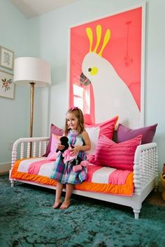 House of Jade created an adorable, fun, colorful room for her daughter. Big art, lots of pink, salmon, teal, and white.