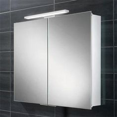 HiB Neutron LED Aluminium Cabinets Art No. 44500 The HiB Neutron LED Aluminium Cabinet offers a double sided mirror door, allowing you to use a mirror when the door is Mirror Cabinets, Bathroom Cabinets, Bathroom Furniture, Bathroom Medicine Cabinet, Bathroom Storage, Bathroom Mirror Lights, Led Mirror, Mirror Door, Double Sided Mirror
