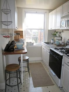 Tiny kitchen with breakfast bar - Love the tiles..not convinced about the furniture...