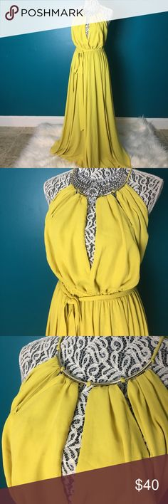 Long yellow flowey dress with gold neckline I purchased 2 dresses like this to do a Mother's Day shoot with my mom. Worn once. This one is a lemon yellow color and is a size small. Splits on both sides but not too high, just enough. Very flowey and gorgeous. Golden neckline and ties in the back. Comes with matching belt. Great condition. Silver rhinestone necklace not apart of dress but it is listed in my closet as well. Feel free to offer and send a reasonable offer. I won't accept unfair…