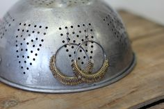 Jewelry display ideas- vintage strainer turned upside down is perfect for pierced earrings. Could even be hung on the wall! http://www.facebook.com/RustyRetroAntiques