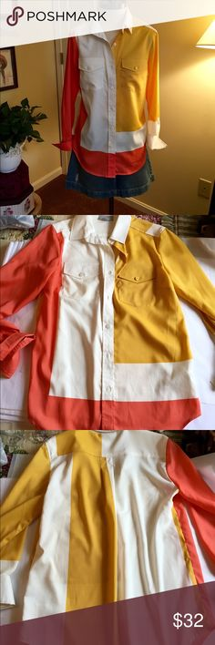 """Colorful Blouse This is a really stunning blouse by Linea Domani. Size medium. 3/4 cuffed sleeves. Button front. Beautiful colors of white, orange and gold. Small thread pull under right pocket and small """"dot"""" on pocket that can probably be removed and is hardly noticeable. Linea Domani Tops Blouses"""