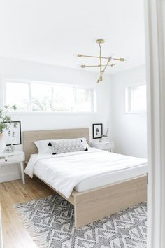 The Essential Scandinavian Decor Guide Scandinavian Bedroom with matching white mid-century modern nightstands and a natural wood bed frame – The Essential Scandinavian Decor Guide Scandinavian Bedroom Decor, Scandinavian Home Interiors, Scandinavian Furniture, Home Decor Bedroom, Scandinavian Design, Bedroom Ideas, Master Bedroom, Scandinavian House, Wood Bedroom