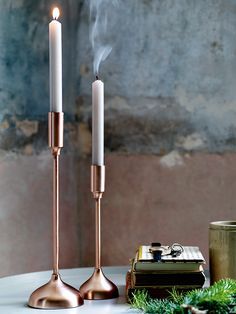 Two Brushed Copper Candlesticks