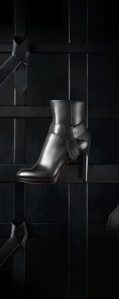 The Fall 2015 Belted Ankle Boot in leather is embellished with a distinctive knot draws inspiration from the belts worn at Nicolas Ghesquière's first fashion show for Louis Vuitton.