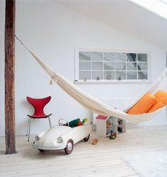 who wouldn't want a tree and a hamock in their bedroom! My niece has a swing hanging from her ceiling in hers!