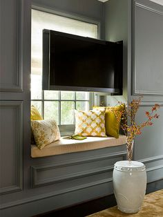 On Occasion If you only watch television on special occasions, consider hidden TV storage. A concealed panel inside this window seat opens and a TV pulls out. For an off-the-shelf solution, place your set on a rolling cabinet or casters, so you can wheel Tv Escondida, Decor Around Tv, Hidden Tv, Living Room Tv, Wall Storage, Hidden Storage, Record Storage, Home Decor Bedroom, Master Bedroom