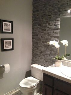 Renovation by: Wendy Location: Nevada City We wanted the look of a stacked stone accent wall in our bathroom. However, we were unable to find a stone veneer that would fit behind our toilet. We decided to use reclaimed pine which we got from used pallets.