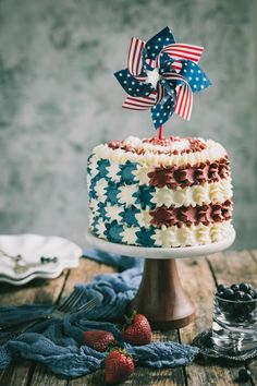 Celebrate Memorial Day with a Strawberry & Blueberry Layer Flag Cake. This vanilla layer poke cake is filled with roasted strawberries & blueberries sweetened with a touch of honey & covered with a delicious American buttercream frosting. Roasted Strawberries, Strawberries And Cream, Poke Cakes, Cupcake Cakes, Cupcakes, Moist Vanilla Cake, Special Birthday Cakes, Flag Cake, Strawberry Blueberry