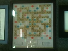 Personalize a scrabble board and frame it.