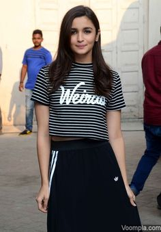 Alia Bhatt looks pretty in a striped H&M crop top with Weirdo printed on it. Her stylist Ami Patel paired the top with a maxi skirt by adidas. Her hair has been done by Ayesha DeVitre and makeup by Vardan Nayak. via Voompla.com