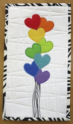 A bunch of rainbow Valentine love by mamacjt, via Flickr