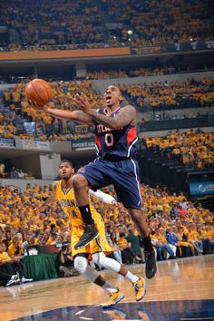 Hawks take 1-0 lead by rolling past Pacers 101-93 - INDIANAPOLIS, IN - APRIL 19: Jeff Teague #0 of the Atlanta Hawks goes up for the layup against the Indiana Pacers in Game One of the Eastern Conference Quarterfinals during the 2014 NBA Playoffs on April 19, 2014 at Bankers Life Fieldhouse in Indianapolis, Indiana. (Photo by Jesse D. Garrabrant/NBAE via Getty Images)