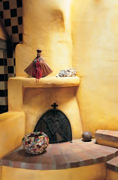 Keep warm by a kiva fireplace is SO New Mexico!