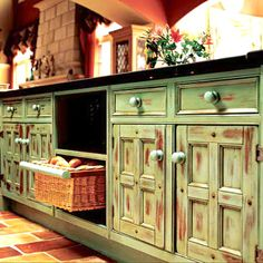 Love these distressed kitchen cabinets!