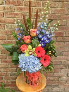Blues, corals and greens! Perfect together.  A floral arrangement with pop!