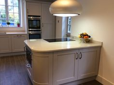 London NW11 Sexy curved units finished in Cashmere with 30mm Quartz Worktops