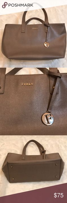 """Furla Daisy Medium Leather Tote Bag in Taupe Furla Daisy Medium Leather Tote Bag in Taupe. Excellent used condition with minimal signs of wear (some small pen marks inside of bag, shown in photo). Overall bag is in amazing condition! Saffiano leather tote with golden hardware. 7"""" Drop shoulder straps. Recessed zip top. Logo nylon lining with one zip and two slip pockets. Metro feet to protect bottom of bag. 9.5""""H x 18""""W x 5.5""""D Furla Bags"""