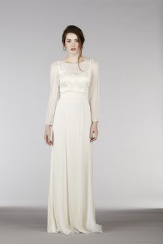 RM6325 l Our play on a long sleeved wedding dress, this elegant and modern dress has a plunge back with a layered front neckline and one-of-a-kind floral hand embroidery that cascades down the front bodice as well as along the sleeves. Its impossibly long silhouette will also elongate the bride.