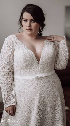 Real plus size bride in a curvy lace wedding gown with long sleeves from Studio Levana. Retailer:Lovely Bride Philadelphia
